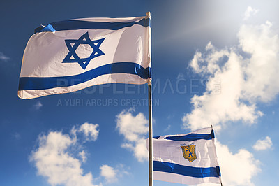 Buy stock photo Shot of the Israeli flag blowing in the wind