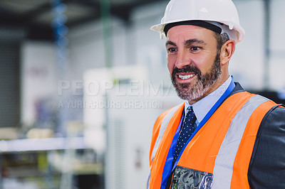Buy stock photo Cropped shot of a cheerful male engineer standing inside of a workshop during the day