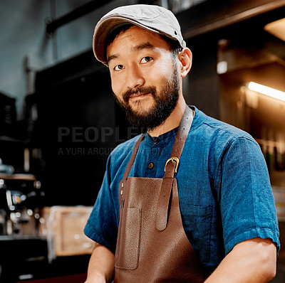Buy stock photo Portrait of a handsome young barista working inside a cafe