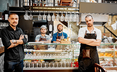 Buy stock photo Portrait of a handsome young businessman posing with his staff inside his cafe