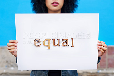 Buy stock photo Shot of an unrecognizable woman holding a placard written