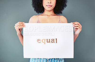 Buy stock photo Shot of an unrecognizable young woman holding up a placard written