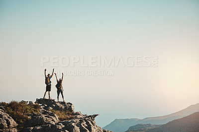 Buy stock photo Shot of a man and woman hiking up a mountain