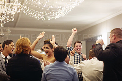 Buy stock photo Cropped shot of a beautiful young newlywed bride dancing along with her wedding guests