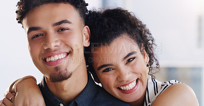 Buy stock photo Portrait of a happy young couple posing together indoors
