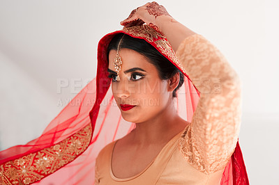 Buy stock photo Shot of a beautiful young woman getting ready for her wedding