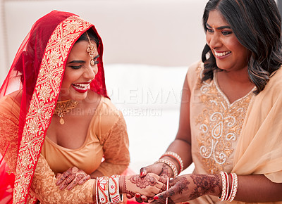 Buy stock photo Shot of a young woman getting her bracelets put on by her bridesmaid on her wedding day