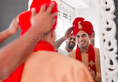Buy stock photo Shot of a young man helping his friend get dressed on his wedding day