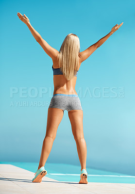 Buy stock photo Rearview shot of an unrecognizable young woman exercising outdoors
