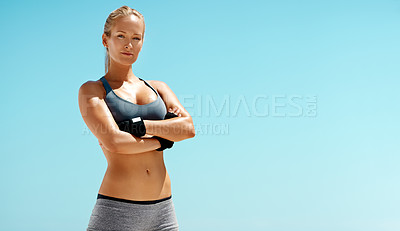 Buy stock photo Cropped portrait of a beautiful young woman standing with her arms crossed while exercising outdoors