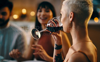 Buy stock photo Cropped shot of a woman enjoying a drink while out with friends