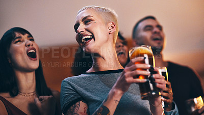 Buy stock photo Shot of a group of friends enjoying drinks at a sports bar