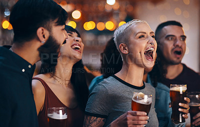 Buy stock photo Shot of a group of friends cheering while watching a sports game at a bar