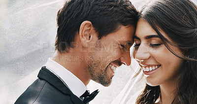 Buy stock photo Cropped shot of an affectionate young newlywed couple sharing an intimate moment on their wedding day