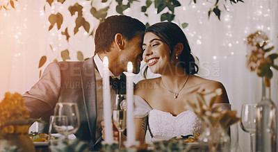 Buy stock photo Cropped shot of an affectionate young groom whispering into his bride's ear at their wedding reception