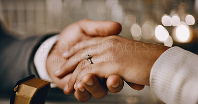 Buy stock photo Closeup shot of an unrecognizable couple holding hands after a marriage proposal