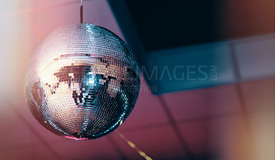 Buy stock photo Still life shot of a disco ball hanged on the roof of a nightclub