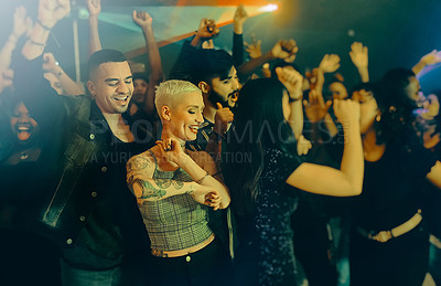 Buy stock photo Cropped shot of a group of energetic friends people dancing at a party in a nightclub