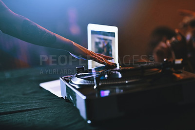 Buy stock photo Cropped shot of an unrecognizable female dj mixing music on a turntable in a nightclub