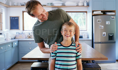 Buy stock photo Cropped shot of an affectionate young father looking at his son while standing in their kitchen at home
