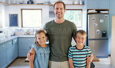 Buy stock photo Cropped portrait of an affectionate young father standing with his two kids in the kitchen at home