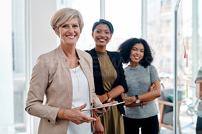 Buy stock photo Portrait of a group of three attractive creative businesswomen working together inside their office