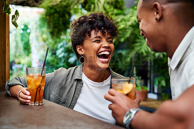 Buy stock photo Shot of a happy young couple having drinks and relaxing together at an outdoor cafe