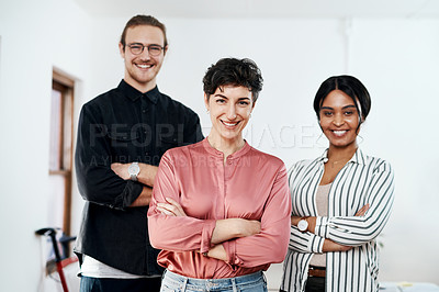 Buy stock photo Cropped portrait of a diverse group of businesspeople standing in the office together with their arms folded