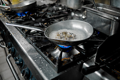 Buy stock photo Cropped shot of clams cooking in a pan in a restaurant kitchen