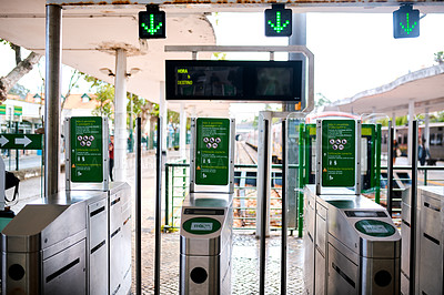 Buy stock photo Cropped shot of a ticket scanner in an empty train station during the day in Portugal