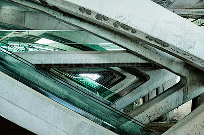 Buy stock photo Cropped shot of the architecture surrounding the escalators in an empty train station during the day in Portugal