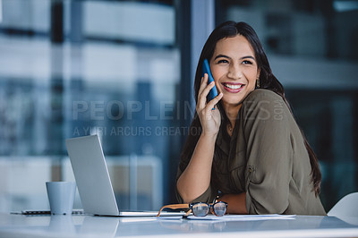 Buy stock photo Cropped shot of an attractive young businesswoman sitting alone in her office and talking on her cellphone