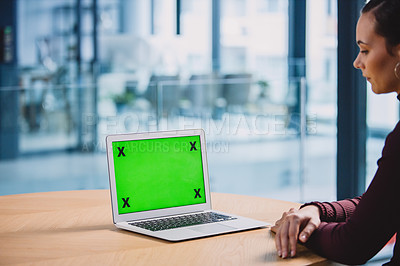 Buy stock photo Cropped shot of an attractive young businesswoman sitting alone in her office and looking at her laptop screen