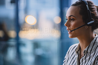 Buy stock photo Cropped shot of an attractive young businesswoman wearing a headset and sitting alone in her office