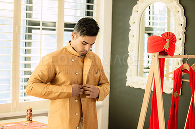 Buy stock photo Shot of a young man getting dressed on his wedding day