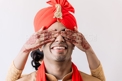 Buy stock photo Shot of a happy young sharing a playful moment with his bride on their wedding day