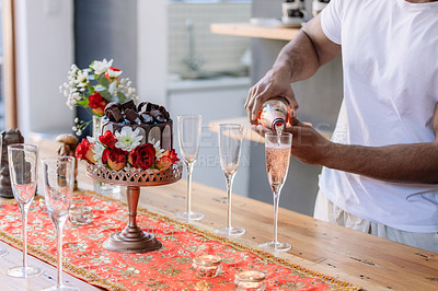 Buy stock photo Cropped shot of an unrecognizable person pouring a glass of champagne at a wedding reception