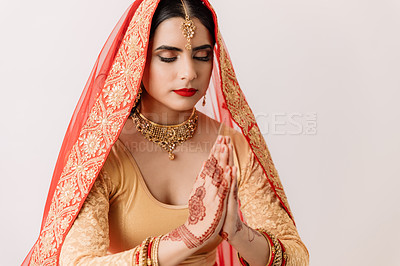 Buy stock photo Studio shot of a beautiful young woman praying on her wedding day