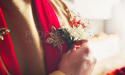 Buy stock photo Cropped shot of a man putting a corsage in his pocket in preparation for his wedding day