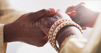 Buy stock photo Cropped shot of an unrecognizable young couple holding hands on their wedding day
