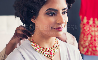 Buy stock photo Shot of a beautiful young woman getting her necklace put on by her bridesmaid on her wedding day