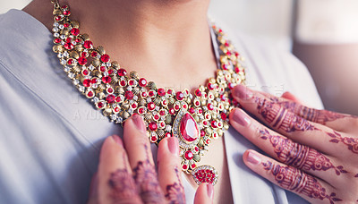 Buy stock photo Cropped shot of an unrecognizable woman putting a necklace on in preparation for her wedding day