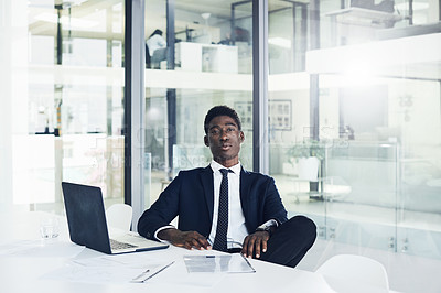 Buy stock photo Portrait of a handsome young businessman working in an office