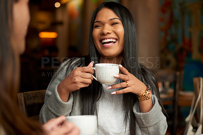 Buy stock photo Cropped shot of an attractive young woman laughing while having coffee with her friend in a cafe