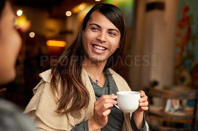 Buy stock photo Cropped shot of an affectionate young gender fluid person having a discussion with their friend while having coffee in a cafe