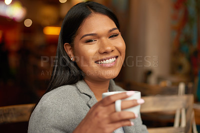 Buy stock photo Cropped portrait of an attractive  young woman smiling while having coffee in a cafe