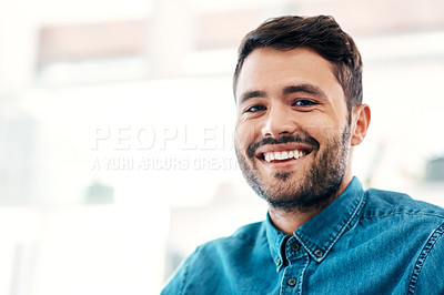 Buy stock photo Cropped portrait of a handsome young businessman smiling while standing in an office office