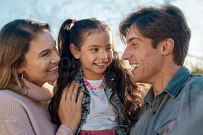 Buy stock photo Shot of a happy young enjoying spending time together in the park
