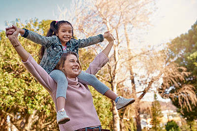 Buy stock photo Shot of an adorable little girl having fun with her mother at the park