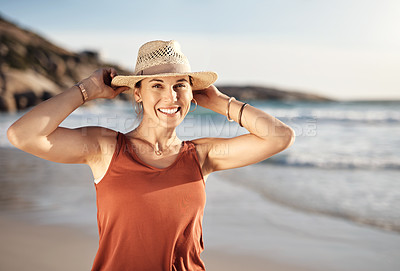 Buy stock photo Cropped shot of a middle aged woman spending the day at the beach
